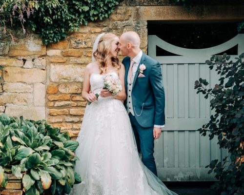 Bride and groom share a moment together at Cotswolds house hotel, Chipping Campden
